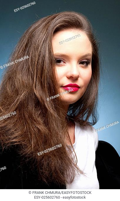 Portrait of a Teenage Girl with Long Brown Hair