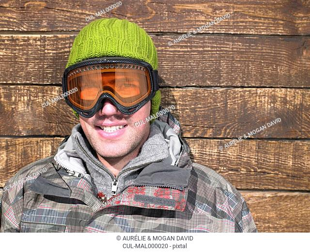 Young man in goggles and snow gear