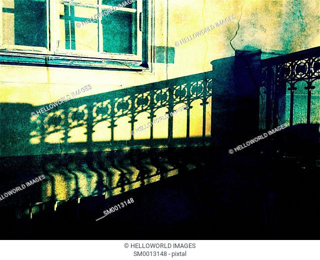 Shadow of ornate metal railing on cracked building wall, Stockholm, Sweden, Scandinavia