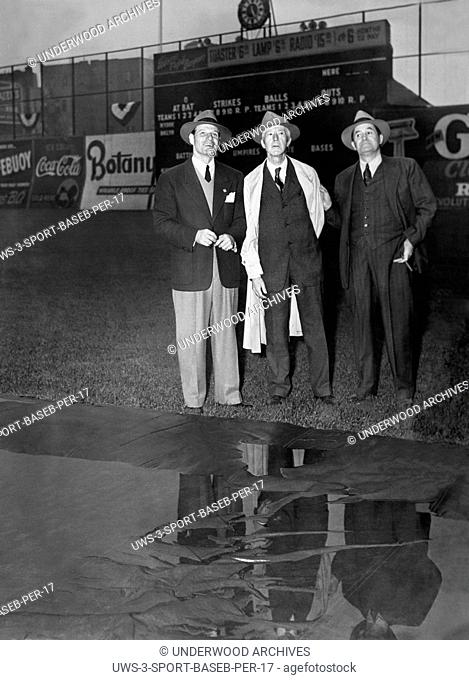 New York, New York: October 3, 1941 Brooklyn Dodger manager Leo Durocher, Baseball Commissioner Kenesaw Landis and New York Yankee manager Joe McCarthy stand at...
