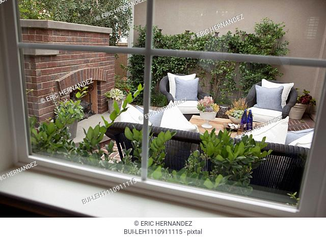 View of dining area with fireplace and plants at a patio