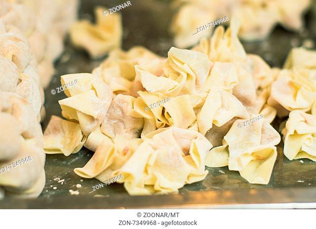 making of wanton or wantan, a chinese dumplings. Photo is taken at Hubu lane snack street in Wuhan, China