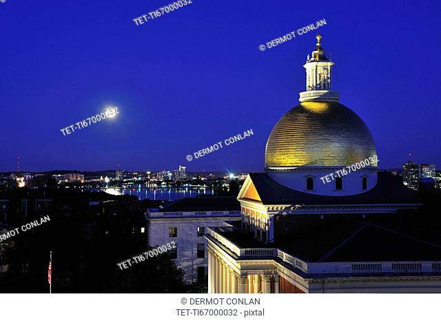Massachusetts State House Dome and city skyline at dusk