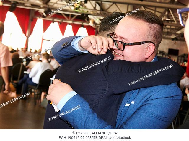 15 June 2019, Berlin: Julian Brüning (CDU), chairman of the Junge Union, wipes off a tear of joy while a party friend embraces him