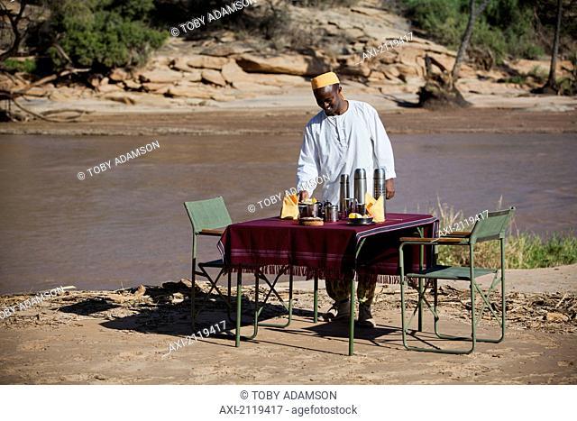 Shaba National Reserve; Kenya, Riverside breakfast table set up for guests at Joy's Camp