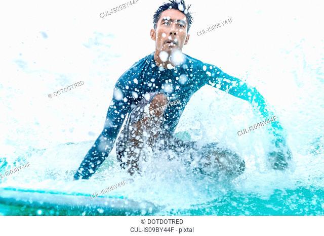 Surfer in action, Pagudpud, Ilocos Norte, Philippines