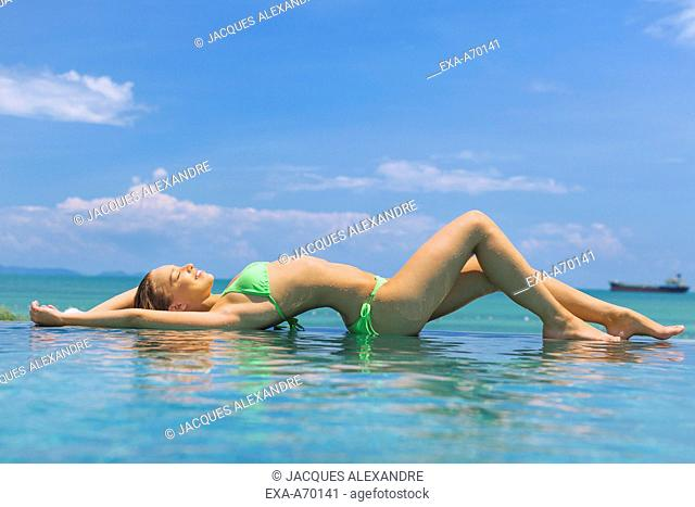 woman lying in swimming pool