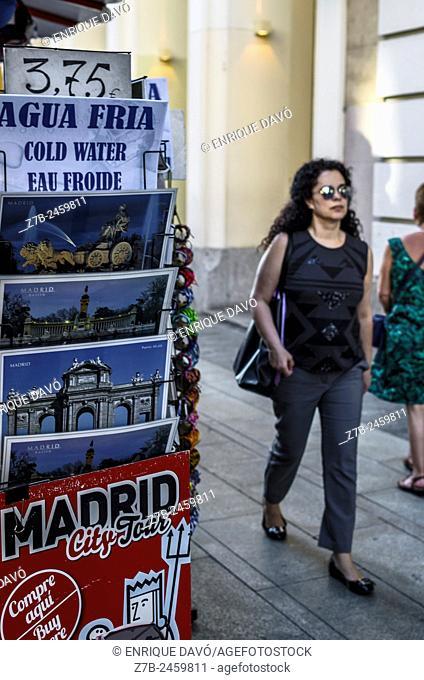 View of a woman walking by Gran Via street, Madrid city, Spain