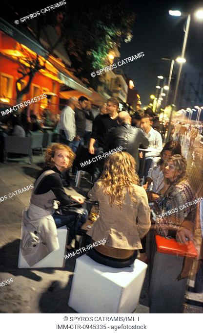 People drinking at a bar. The entire Gazi neighborhood has been restored and renovated by the city authorities. It is now a popular location for nightlife