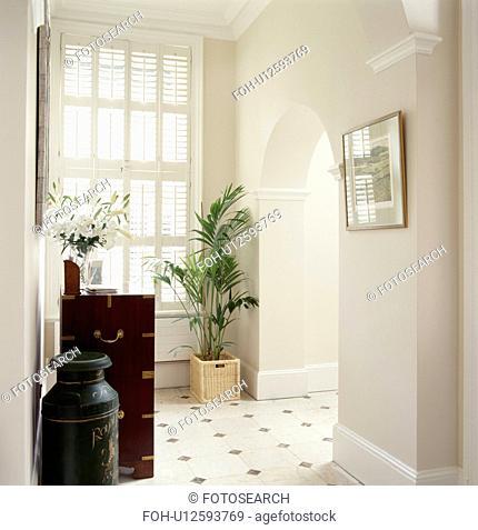 Tall window in modern white hall
