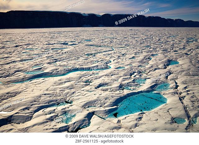 Aerial views of Melt Pools and melt rivers on Petermann Glacier, in remote northwest Greenland. The 80km long, 20km wide floating tongue of Petermann Glacier...