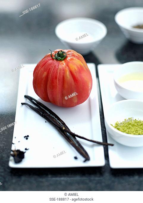 Ingredients for sliced tomato with vanilla-flavored olive oil and lime zests