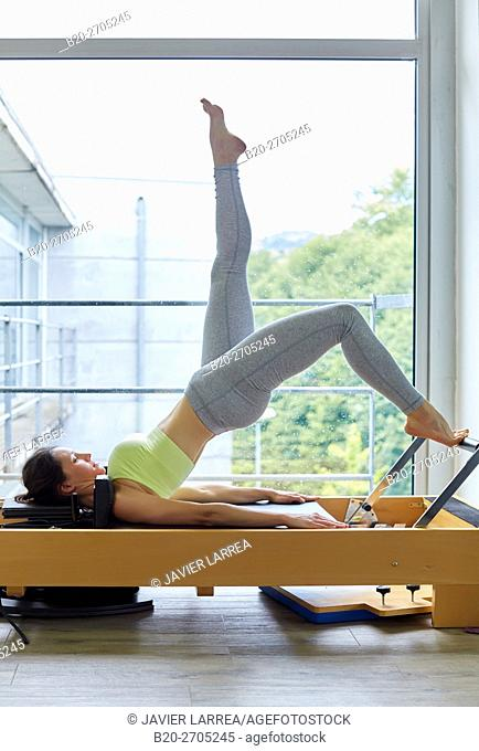Pilates reformer, Woman training in gym