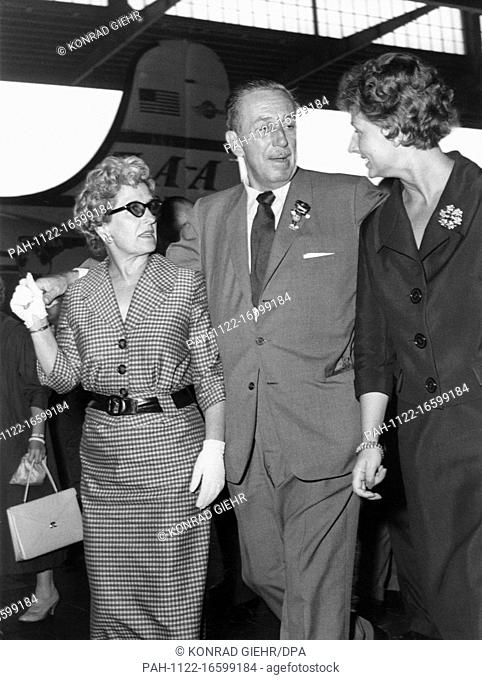 Walt Disney, wife Lillian Marie Disney (l) and the chief of protocol of the film festival, Mrs Succar, arriving at Berlin Tempelhof airport on 30 June 1958 on...