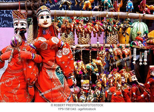 Display of puppets on a market stall, Anjuna Market, Goa, India