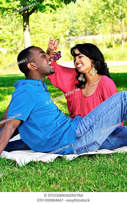 Young romantic couple having picnic in summer park