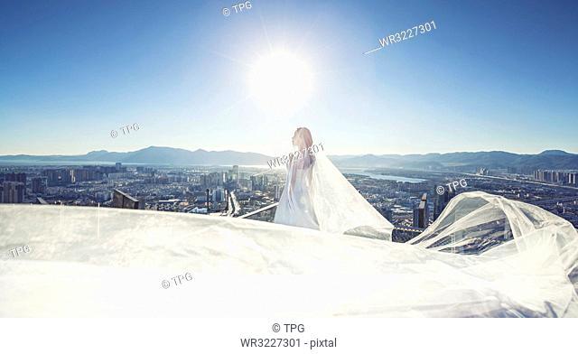 Wedding dress over the city
