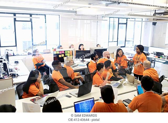 Hackers coding for charity at hackathon