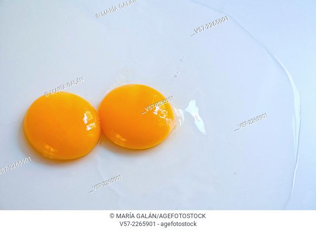 Two eggs on white surface