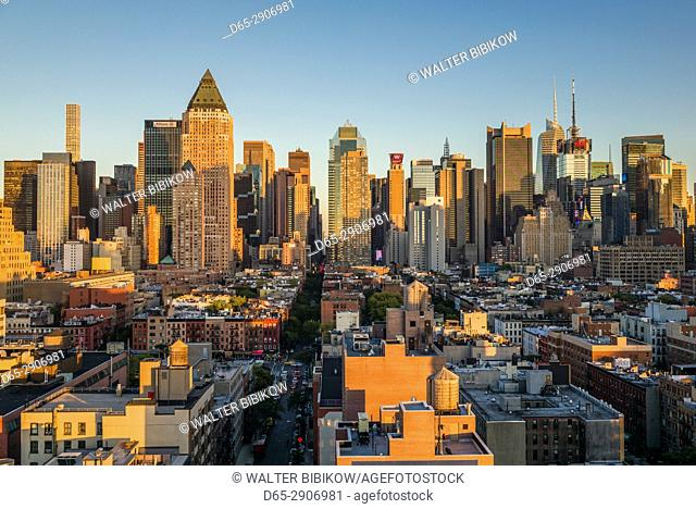 USA, New York, New York City, Mid-Town Manhattan, elevated city skyline from the west, sunset