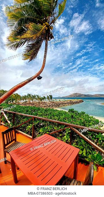 Fiji, Taweva Island, table and chairs on a balcony on the beach, palm, sea