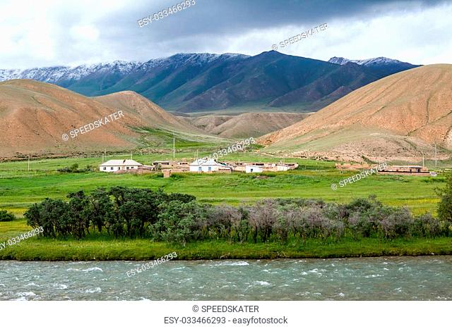 Village in mountains in cloudy weather, Tien Shan, Kyrgyzstan