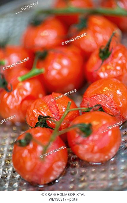 Roasted tomatoes on a silver baking tray