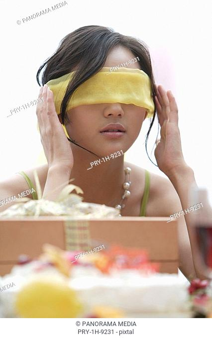 Blindfolded woman with gift
