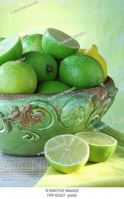 Lemons and limes in a bowl