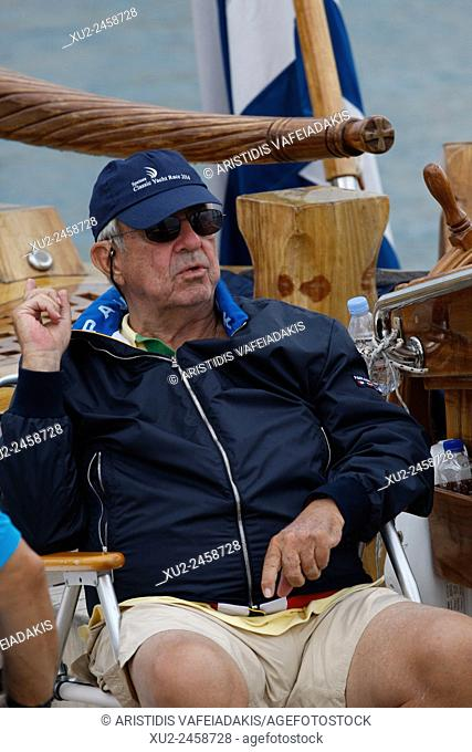 """King Constantine of Greece, on his traditional boat """"""""Afroessa at the port of Spetses island during the """"""""Spetses Classic Yacht Race Regatta"""""""""""