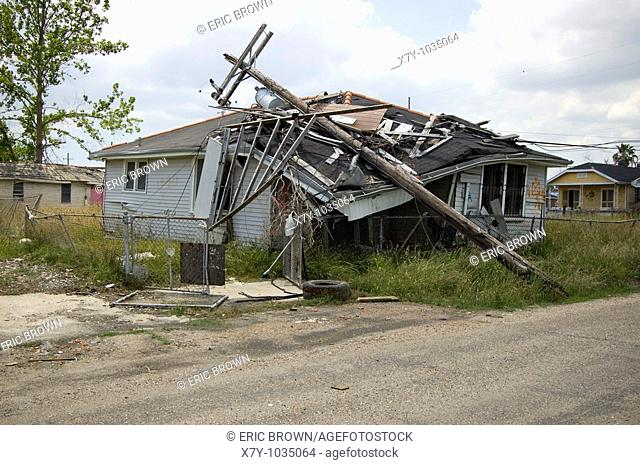 A power pole fell on top of a home in the Lower Ninth Ward, New Orleans