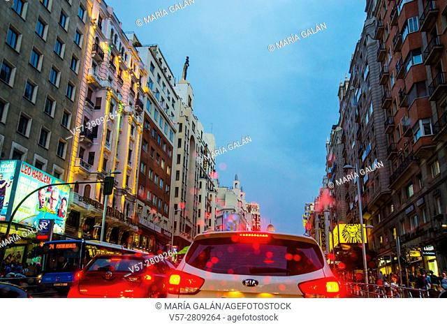 Traffic in Gran Via street, night view. Madrid, Spain