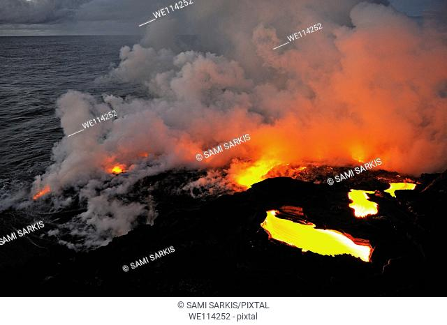Steam rising off lava flowing into ocean, Kilauea Volcano, Big Island, Hawaii Islands, Usa