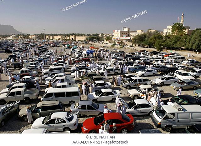 Second-hand vehicles for sale at the Friday souk in Nizwa in Oman
