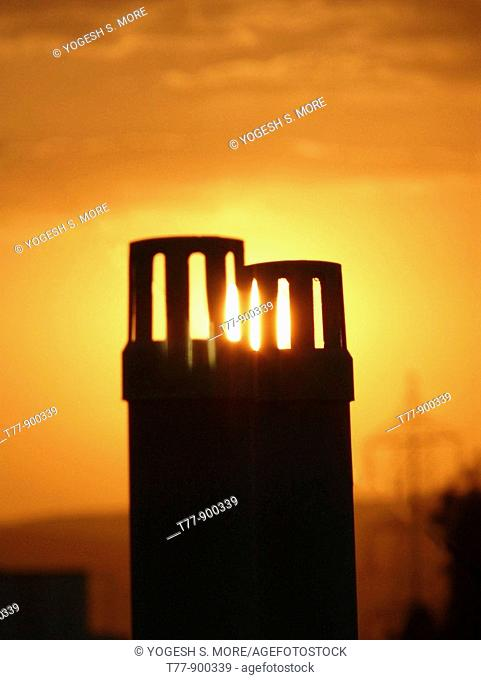 Sunset against drain pipes
