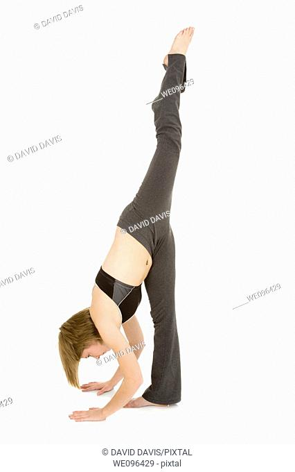 caucasian teenager practing yoga on a white background