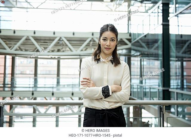 Portrait of confident businesswoman with arms crossed