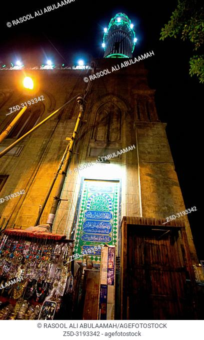 Cairo, Egypt – November 5, 2018: photo for The Shrine of Imam Hussein in Khan el-Khalili in Cairo city capital of Egypt. and shows one minaret and huge building