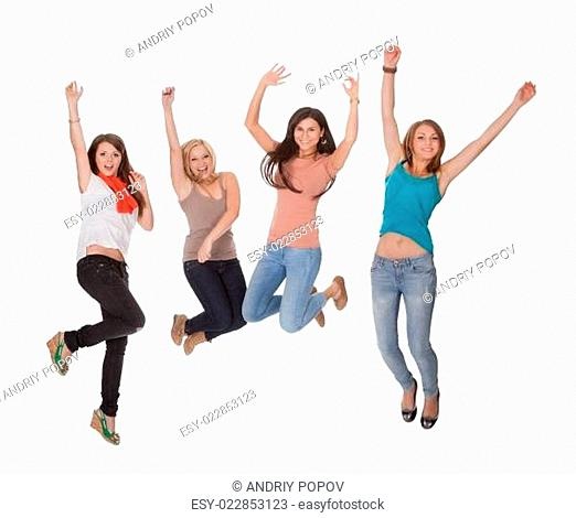 Four young woman jumping for joy