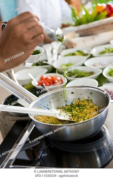 A chef preparing saffron rice Mauritus