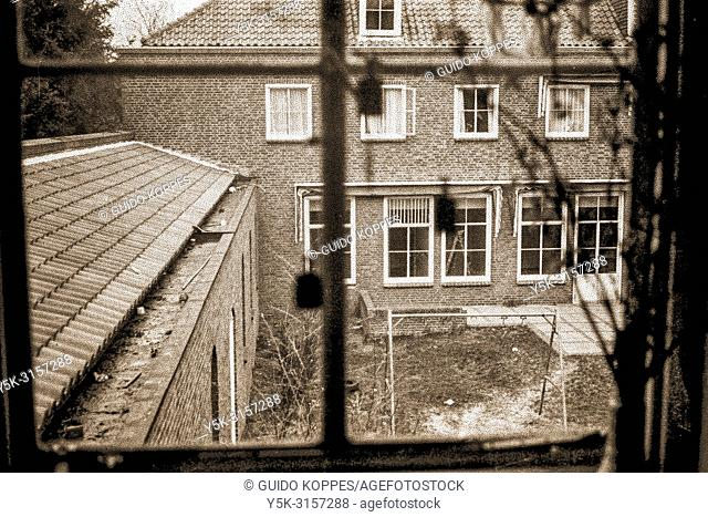 Breda, Netherlands. View from a 2nd floor bedroom window of a former monastery and hospital building, into a former monastery garden