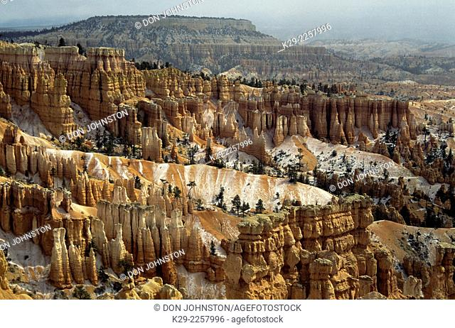 Sandstone hoodoos with spring snow, Bryce Canyon National Park, Utah, USA
