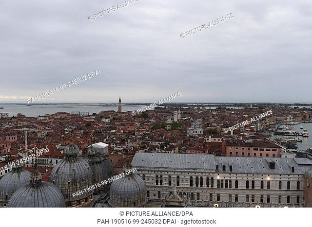 12 May 2019, Italy, Venedig: Eastern view from Campanile. From the Markusturm clouds lie over the city of Venice. This is where the Art Biennale is currently...