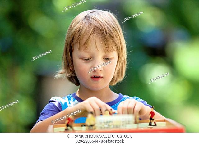 Boy Playing Football Board Game Outdoors