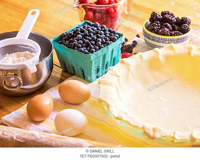 Ingredients for berry pie on table