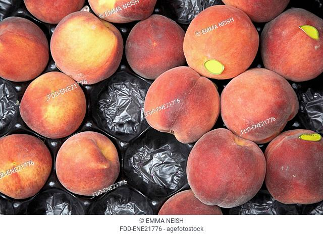 Overhead View Of Fresh Peached In Tray