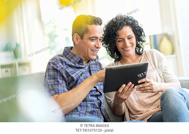 Couple using digital tablet together