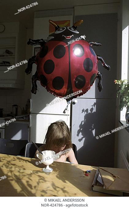 A small girl and a big inflatable ladybird  Sweden