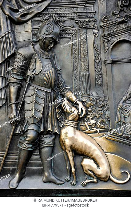 Bronze relief Nobleman with dog on the statue of John of Nepomuk, Charles Bridge, Prague, Bohemia, Czech Republic, Europe