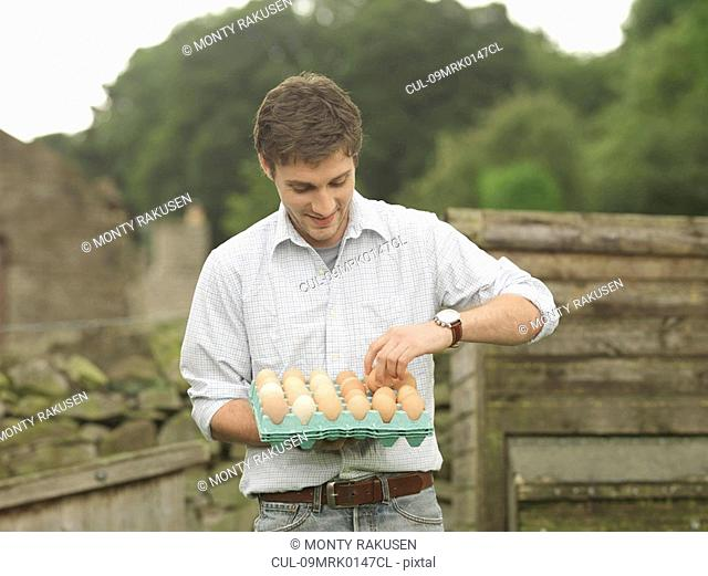 Farmer With Tray Of Eggs